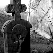 Black and white photography, graveyard, tombstone with cross, Canyoncito, New Mexico.