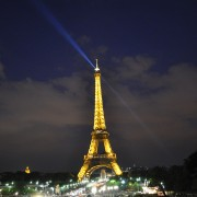 Eiffel Tower lit up at night, cityscape, Paris France. Travel photography.