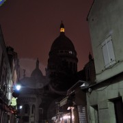 Sacre Cour, Montmarte streets at night , rain, Paris, France.