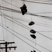 Black and White grainy photo, shoes on a wire, powerlines, San Diego, CA.