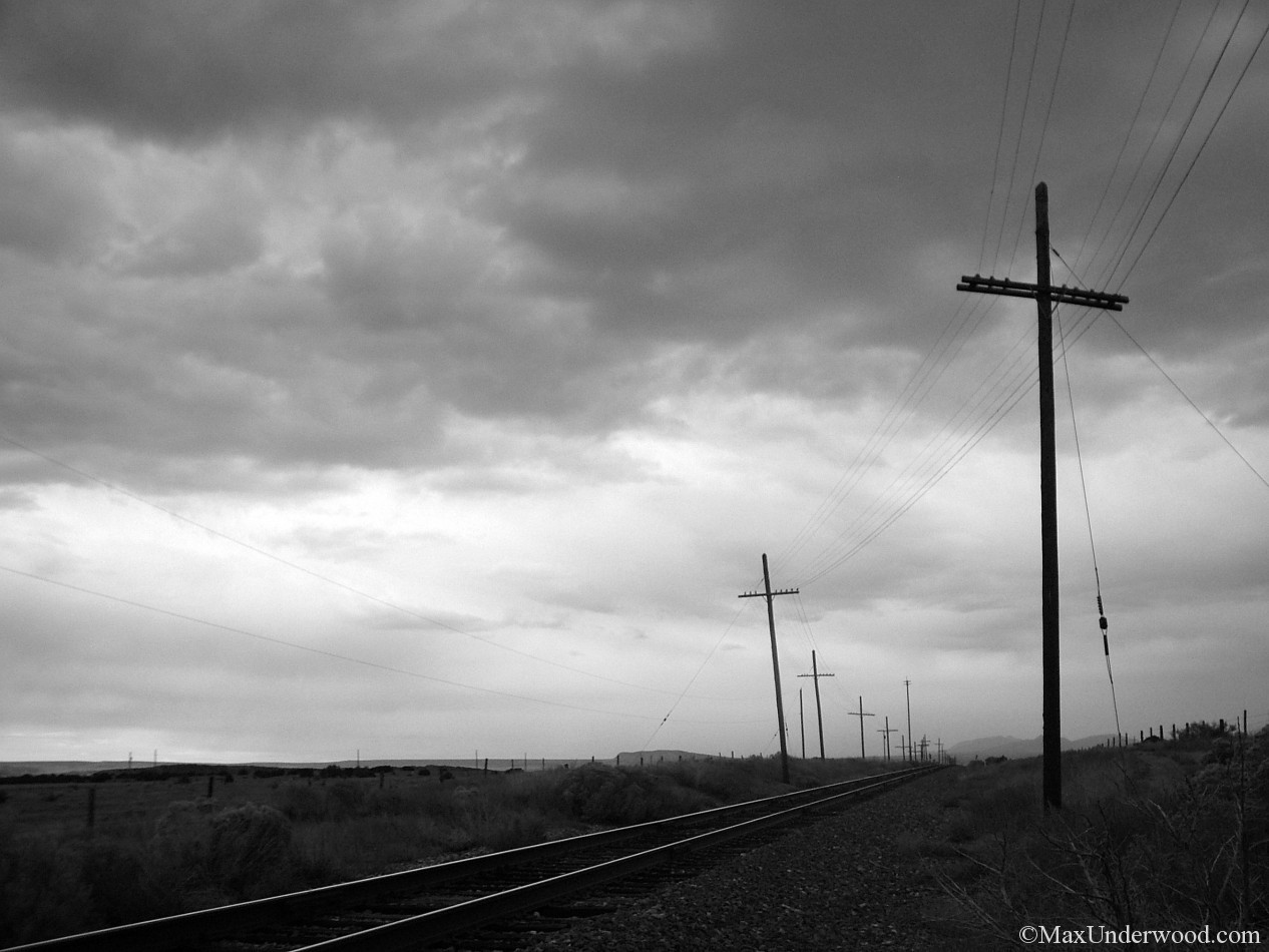 Rail road tracks and telephone poles, Lamy, New Mexico. Black and white photgraphy.